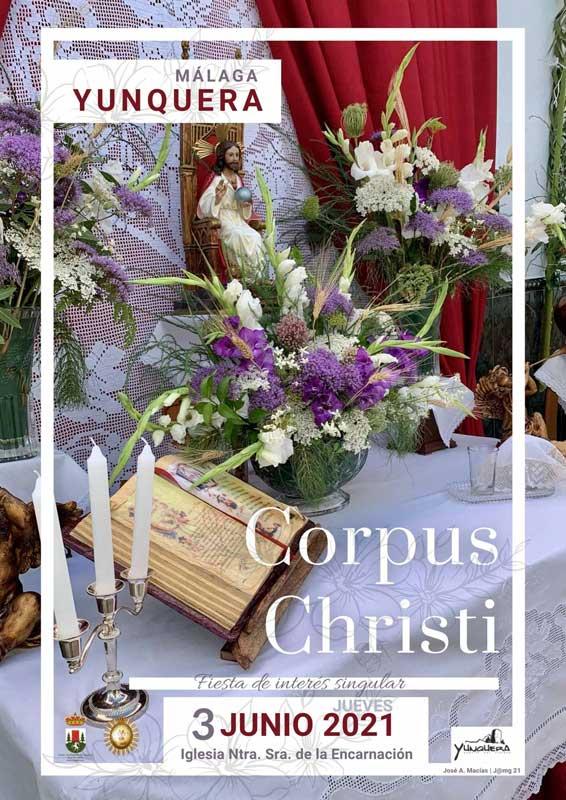 Corpus Christi Yunquera - Cartel 2021- Mesa de descanso en calle Cerecillo con libro flores violetas y símbolos del día del señor.